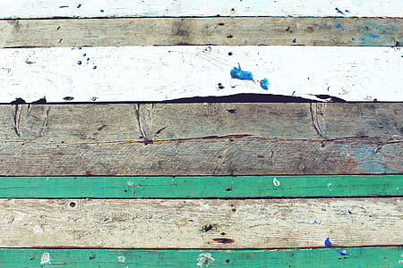 brown, white, and green wooden plank