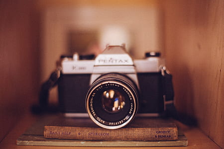 black and grey Pentax camera