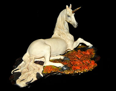 white ceramic unicorn figurine