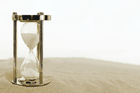 photo of clear hourglass with chrome steel base