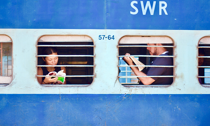 man and woman holding books inside SWR vehicle