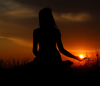 silhouette photograph of woman during sunset