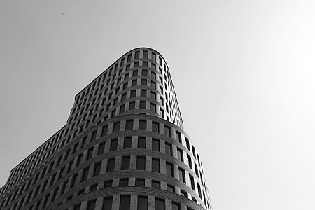 low angle grayscale photography of high raise building