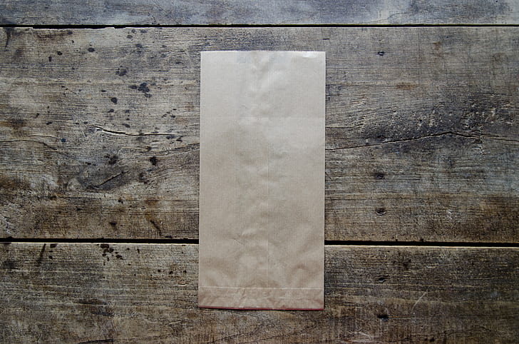 brown paper bag on brown wooden surface