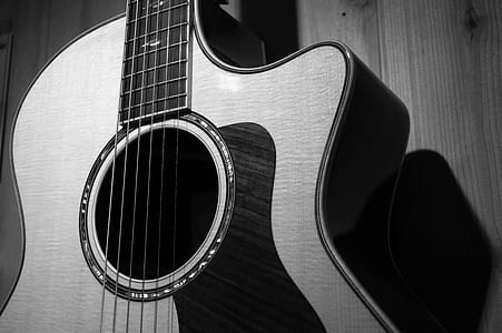 cut-away acoustic guitar grayscale photo