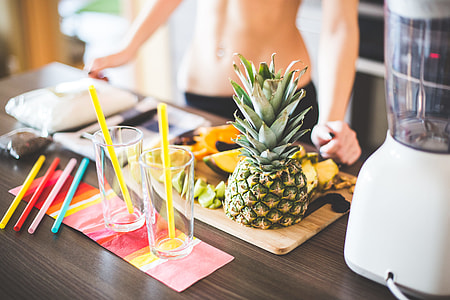 Fitness Girl Preparing Healthy Fruit Milkshake