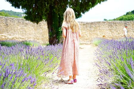 girl wearing pink dress beside lavender flower field