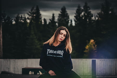 woman in black sweater posing for photo