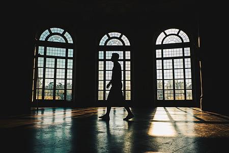 man walking near window