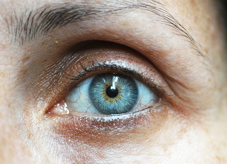 person's left blue eye