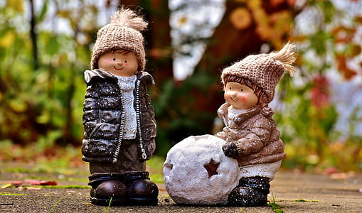 two boy playing soccer ball dolls