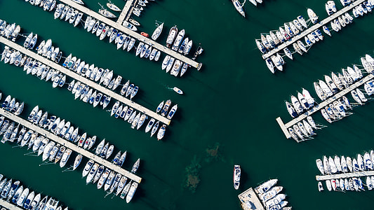 aerial photography of group of boats near dock during daytime