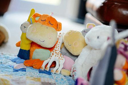 animal plush toys on blue textile