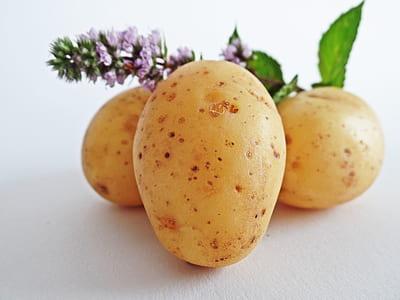 three brown potatoes