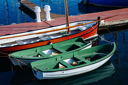 Two small boats sit in the harbour in Barcelona, Spain. Image captured with a Canon DSLR