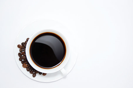white ceramic cup of coffee with saucer