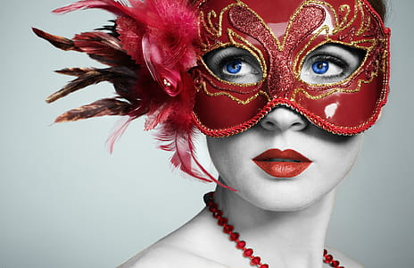 woman wearing red masquerade mask