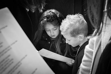 two girl and boy reading