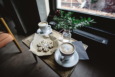 coffee mug on table with cookies