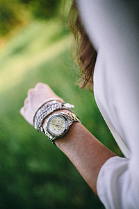 Silver watch on the girl's arm