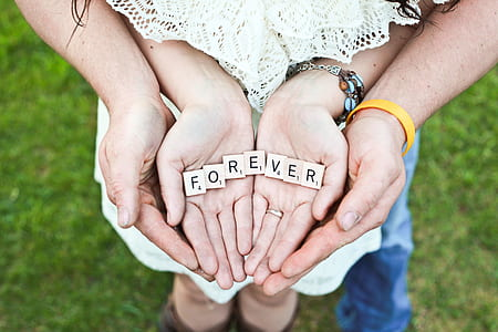 Forever scrabble letters on person hand