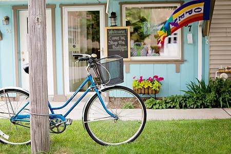 blue dutch bicycle lock on post