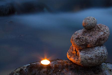 tealight beside balance stones