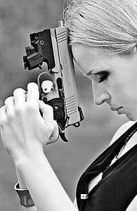 woman holding handgun