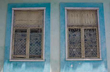 A pair of blue window details from Old Havana, Cuba. Image captured with a Canon DSLR