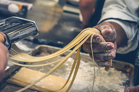 person making pasta