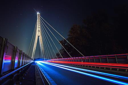 time lapse photo of suspension bridge
