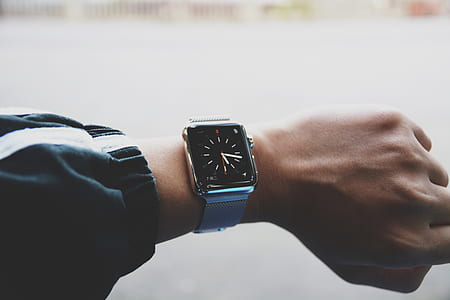 silver Apple Watch with silver milanese strap