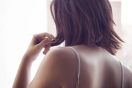woman wearing white spaghetti strap top