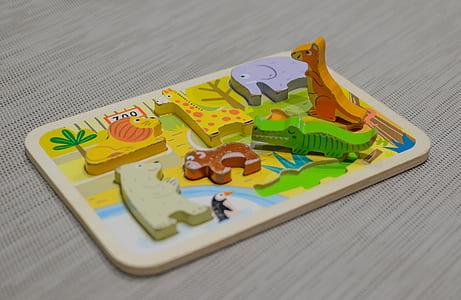 animal peg board on beige surface