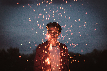 photography of man playing fire