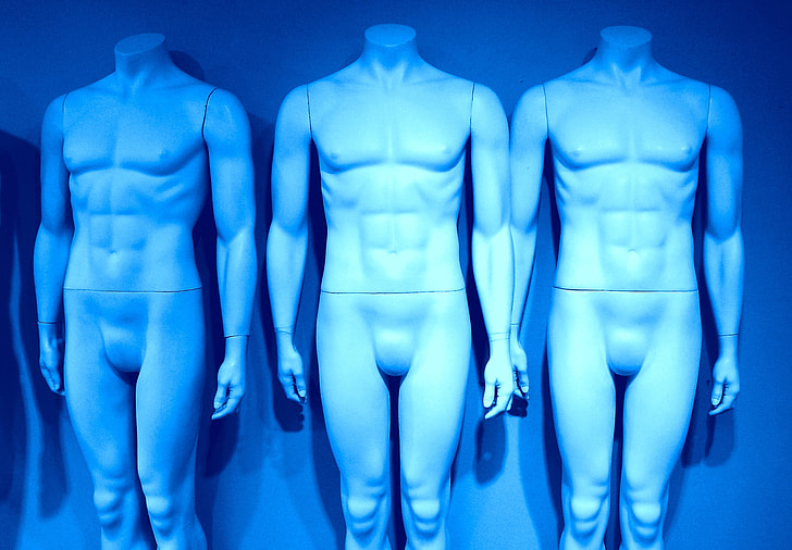 three white male mannequins