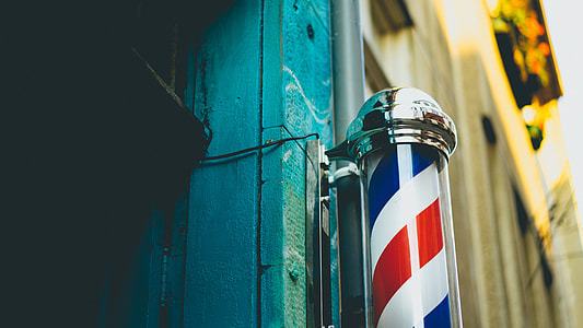 white, red, and blue barber pole