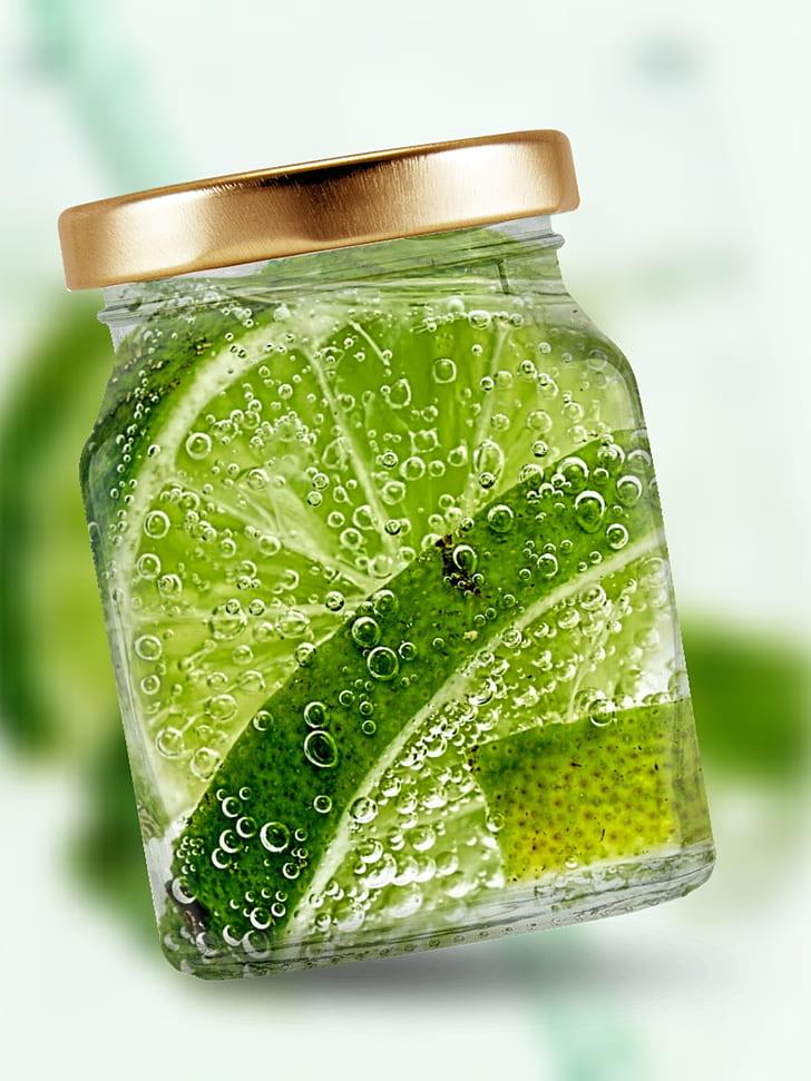 sliced of lemons inside of glass jar