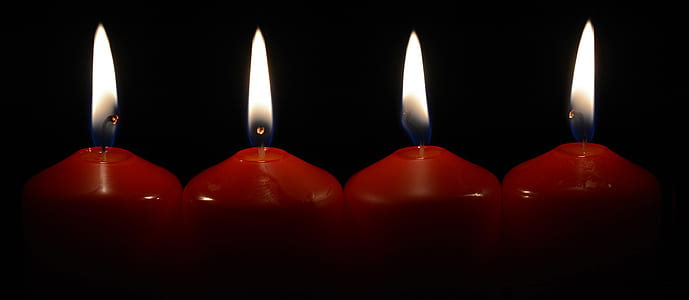 four red lighted candles