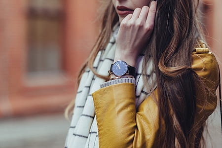 woman wearing black wrist watch