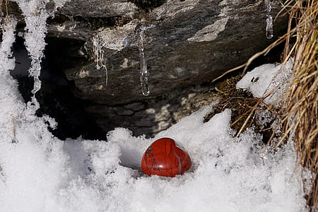 heart-shape red stone surrounded by ice