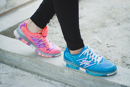 person wearing blue and pink athletic shoes