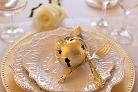 cat bell on dinner plate
