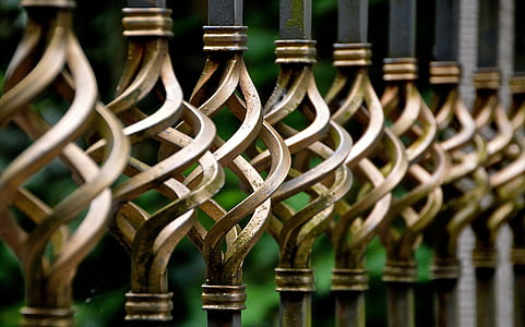 tilt shift lens photography of metal rail