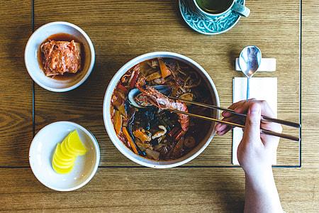 Eating Korean seafood stew