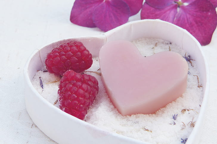 heart-shaped soap and strawberries on heart-shaped box