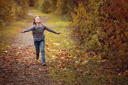 girl wearing long-sleeved shirt running