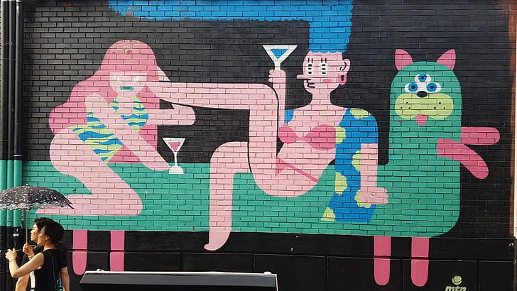 woman in pink bikini riding on animal graffiti