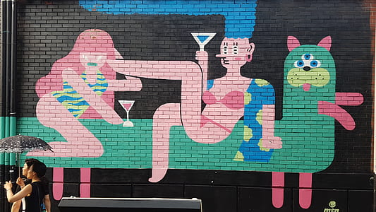 woman in pink bikini riding on animal graffiti
