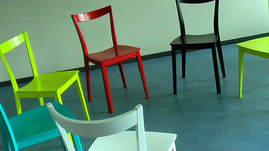 six assorted-color chairs on blue floor